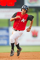 Tyler Saladino #1 of the Kannapolis Intimidators hustles towards third base against the Greensboro Grasshoppers at Fieldcrest Cannon Stadium August 3, 2010, in Kannapolis, North Carolina.  Photo by Brian Westerholt / Four Seam Images