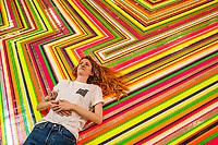 BNPS.co.uk (01202 558833)<br /> Pic: MaxWillcock/BNPS<br /> <br /> Pictured: Gallery Manager Jojo Begley on 'Zobop (Fluorescent)', a floor installation made from vinyl tape by artist Jim Lambie in 2006, at the GIANT gallery in Bournemouth.<br /> <br /> 'Big Medicine', an exhibition celebrating our connection with one another in public space, is the inaugural display in GIANT, a new 15,000 square foot gallery in a former Debenhams in Bournemouth.