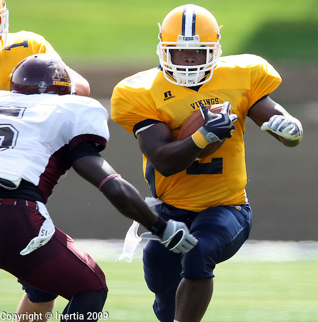 SIOUX FALLS, SD - SEPTEMBER 12:  Joe Clark #2 of Augustana looks to get past the defense of Devahn Murphy #5 of Minnesota Crookston in the second quarter Saturday afternoon at Kirkeby-Over Stadium. (Photo by Dave Eggen/Inertia).