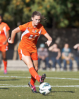 University of Miami defender Tara Schwitter (24) passes the ball. .After two overtime periods, Boston College (gold) tied University of Miami (orange), 0-0, at Newton Campus Field, October 21, 2012.