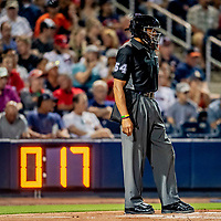 23 February 2019: MLB Umpire CB Bucknor works home plate with a pitch clock on the backstop counting down the seconds between pitches during a Spring Training game between the Washington Nationals and the Houston Astros at the Ballpark of the Palm Beaches in West Palm Beach, Florida. The Nationals walked off with a 7-6 Opening Game win to start the Grapefruit League season. Mandatory Credit: Ed Wolfstein Photo *** RAW (NEF) Image File Available ***