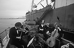 Ullapool Scotland. 1986. Loch Broom, the Edinburgh String Quartet playing to a Bulgarian factory fishing boat.