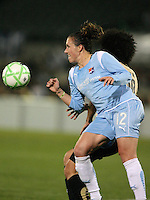 Megan Schnur (12) of Sky Blue muscles Eriko Arakawa (30) of FC Gold Pride off the ball.  Sky Blue FC and FC Gold Pride battled to a 1-1 draw in Bridgewater, NJ on Saturday, April 11, 2009.