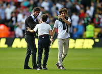 Quique Flores manager of Watford celebrates with boys ( family ?) after the final whistle   during the Barclays Premier League match Watford and Swansea   played at Vicarage Road Stadium , Watford