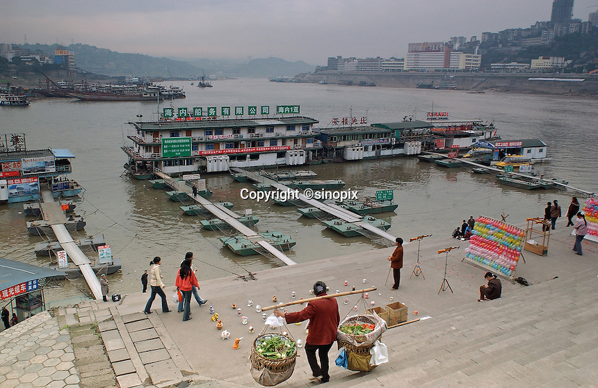 "Chaotianmen Port in Chongqing, it is located at the end of Three Gorges. Chongqing is China's largest city and is often termed a ""super-city"". It is at the far shore of the 600 km long Three Gorges Dam and is the ""gateway to western China"". Large sums of money are being pumped into the  area and infrastructural projects and building development is ongoing..16-NOV-04"