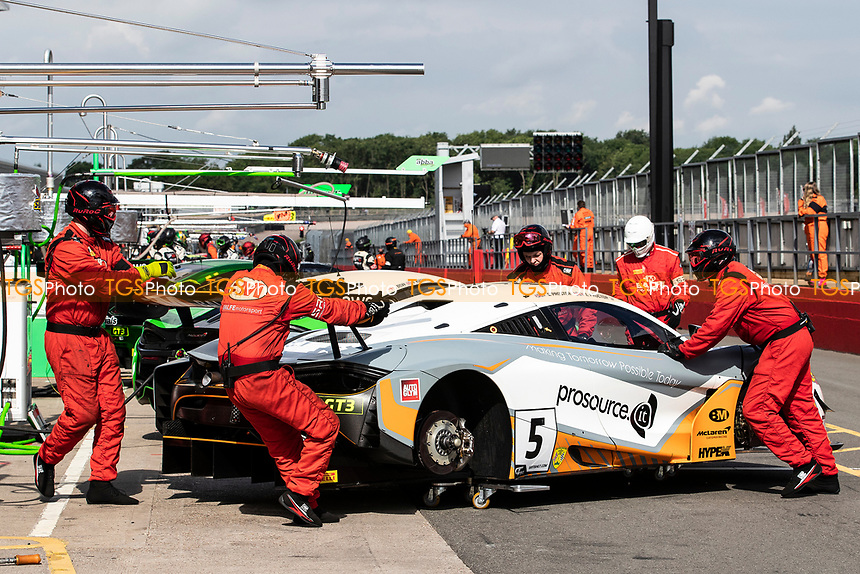 The pit crew push Stewart Proctor & Lewis Proctor, McLaren 720S GT3, Balfe Motorsport vehicle out of the garage during the British GT & F3 Championship on 11th July 2021