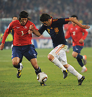 David Villa looks to spring his dribble past Chile's Waldo Ponce. Spain won Group H following a 2-1 defeat of Chile in Pretoria's Loftus Versfeld Stadium, Friday, June 25th, at the 2010 FIFA World Cup in South Africa..