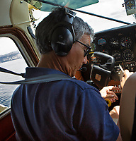 Pilot Alberto Rossi prepares for takeoff from Clear Lake in N4833C, his Cessna 185 on floats, Clear Lake, Lake County, California