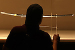 June 26, 2010 - Tokyo, Japan -A visitor looks at a long sword (katana) during The 1st Sword Craftsmen Exhibition of the NBSK (Nihon Bunka Shinko Kyokai) at Okura Musem of Art located in Okura Hotel in Tokyo, Japan, on June 26, 2010. The event runs from June 13 to July 25 and let sword masters show their skills such as sword polishing, sword fittings and mounting to visitors.