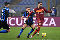 Stefan de Vrij of FC Internazionale and Lorenzo Pellegrini of AS Roma compete for the ball during the Serie A football match between AS Roma and FC Internazionale at Olimpico stadium in Roma (Italy), January 10th, 2021. Photo Andrea Staccioli / Insidefoto
