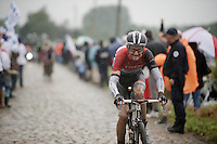 Fränk Schleck (LUX/Trek Factory Racing) over the cobbles; is he grinding or smiling that this is the last of the pavé sections? <br /> <br /> 2014 Tour de France<br /> stage 5: Ypres/Ieper (BEL) - Arenberg Porte du Hainaut (155km)