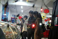 China. Jilin Province. Young people shopping in the town of Yanji, close to the border with North Korea. The town is part of the Korean Autonomous Prefecture in the north-east of the country. 2011