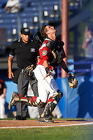 Batavia Muckdogs catcher Blake Anderson (26) looks for a foul ball pop up in front of umpire David Martinez during a game against the Mahoning Valley Scrappers on June 23, 2015 at Dwyer Stadium in Batavia, New York.  Mahoning Valley defeated Batavia 11-2.  (Mike Janes/Four Seam Images)