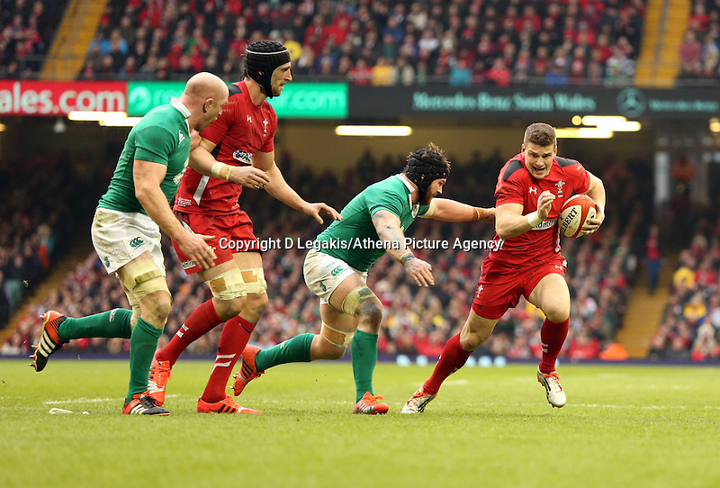 Pictured: Scott WIlliams of Wales (R) avoids a tackle by Sean O'Brien of Ireland (3rd L) and carries on to score a try Saturday 14 March 2015<br /> Re: RBS Six Nations, Wales v Ireland at the Millennium Stadium, Cardiff, south Wales, UK.