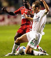 DC United defender Bryan Namoff (26) attempts to tackle the ball away from Chicago Fire midfielder Thiago (10).  The Chicago Fire tied the DC United 1-1 at Toyota Park in Bridgeview, IL on July 22, 2006.