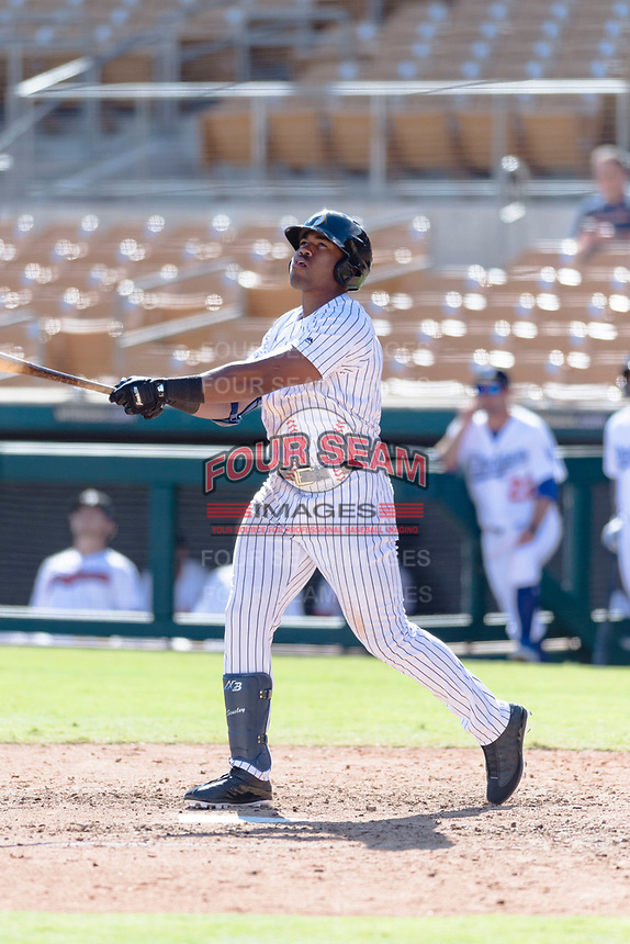 Glendale Desert Dogs designated hitter Steven Sensley (21), of the New York Yankees organization, follows through on his swing during an Arizona Fall League game against the Scottsdale Scorpions at Camelback Ranch on October 16, 2018 in Glendale, Arizona. Scottsdale defeated Glendale 6-1. (Zachary Lucy/Four Seam Images)