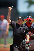 Umpire Louie Krupa signals to the official scorer during a Florida State League game between the Florida Fire Frogs and Clearwater Threshers on April 24, 2019 at Spectrum Field in Clearwater, Florida.  Clearwater defeated Florida 13-1.  (Mike Janes/Four Seam Images)