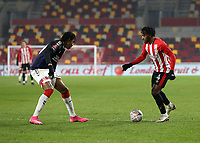 9th January 2021; Brentford Community Stadium, London, England; English FA Cup Football, Brentford FC versus Middlesbrough; Tariqe Fosu of Brentford takes on Djed Spence of Middlesbrough