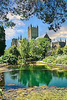 Gardens and well pools of the Bishops Palace of the the medieval Wells Cathedral built in the Early English Gothic style in 1175, Wells Somerset, England