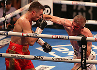 9th October 2021; M&S Bank Arena, Liverpool, England; Matchroom Boxing, Liam Smith versus Anthony Fowler; LIAM SMITH (Liverpool, England)with an overhand right to ANTHONY FOWLER (Liverpool, England)  during their WBA International Super-Welterweight Title contest