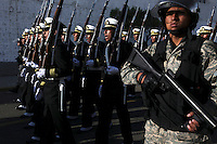 Bolivian Navy soldiers march to mourn the day they lost their ocean to Chile in the War of the Pacific. Bolivia lost what is now northern Chile in a war over nitrates leaving Bolivia without access to the ocean.