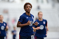 ORLANDO CITY, FL - FEBRUARY 21: Crystal Dunn #19 of the USWNT warms up before a game between Brazil and USWNT at Exploria Stadium on February 21, 2021 in Orlando City, Florida.