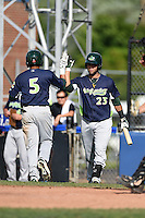 Vermont Lake Monsters second baseman Gabriel Santana (23) high fives third baseman Jose Brizuela (5) after a home run during a game against the Jamestown Jammers on July 13, 2014 at Russell Diethrick Park in Jamestown, New York.  Jamestown defeated Vermont 6-2.  (Mike Janes/Four Seam Images)