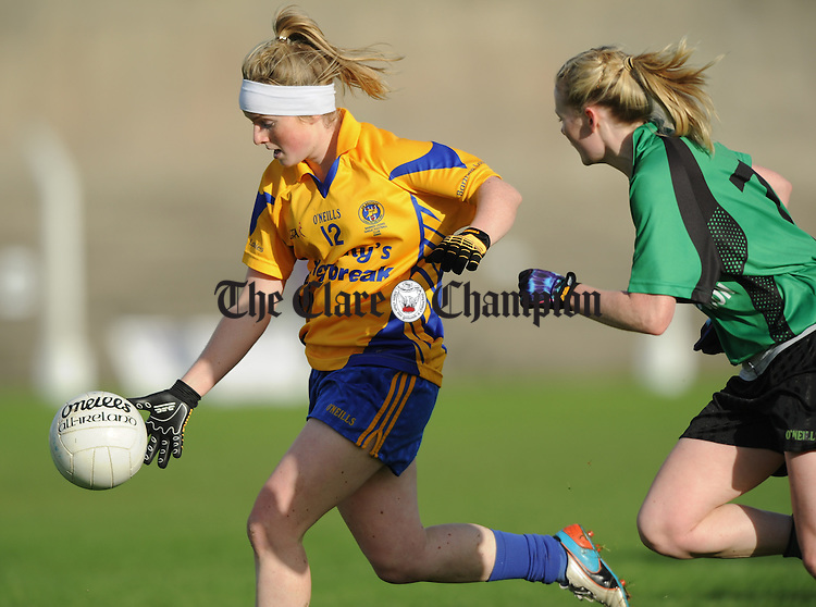Naomi Carroll of The Banner in action against Vera Foley of St Valentine's during their Senior Ladies Munster football final at Kilmallock. Photograph by John Kelly.
