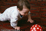 8 month old baby girl crawling toward ball horizontal