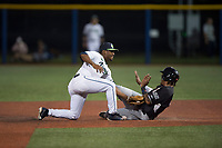 Hillsboro Hops second baseman Keshawn Lynch (8) tags Wander Franco (23) on a stolen base attempt during a Northwest League game against the Salem-Keizer Volcanoes at Ron Tonkin Field on September 1, 2018 in Hillsboro, Oregon. The Salem-Keizer Volcanoes defeated the Hillsboro Hops by a score of 3-1. (Zachary Lucy/Four Seam Images)