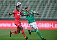 18th May 2020, WESERSTADION, Bremen, Germany; Bundesliga football, Werder Bremen versus Bayer Leverkusen;  Edmond Tapsoba (Leverkusen) holds off  Davie Selke (Bremen).