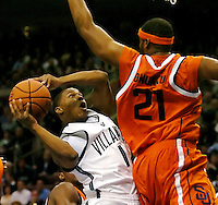 Villanova guard Kyle Lowry (1) shoots a basket past Syracuse forward Arinze Onaku (21) in the first half  in Philadelphia, January 21, 2006. REUTERS/Bradley C Bower.