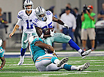 Dallas Cowboys wide receiver Kevin Ogletree (85) and Miami Dolphins defensive tackle Kheeston Randall (97) in action during the pre- season game between the Miami Dolphins and the Dallas Cowboys at the Cowboys Stadium in Arlington, Texas. Dallas defeats  Miami 30 to 13..