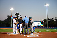 Siena Saints head coach Tony Rossi (40) during the lineup exchange with Florida Gators head coach Kevin O'Sullivan (7), home plate umpire Josh Miller, and field umpires Chris Tipton (hidden), Hank Himmanen (center), Shane Livensparger (left) before a game on February 16, 2018 at Alfred A. McKethan Stadium in Gainesville, Florida.  Florida defeated Siena 7-1.  (Mike Janes/Four Seam Images)