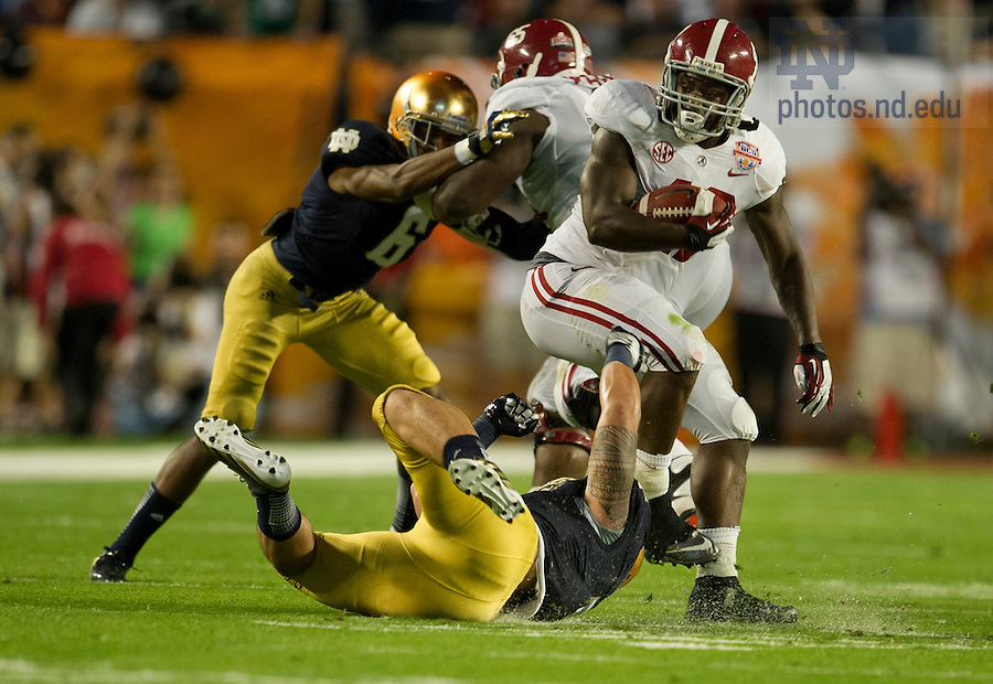 Jan. 7, 2013; Linebacker Manti Te'o tries to stop Alabama running back Eddie Lacy during the first half of the 2013 BCS National Championship in Miami, Florida. Alabama defeated Notre Dame 42 to 14. Photo by Barbara Johnston/University of Notre Dame