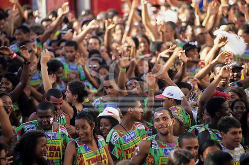 Salvador, Brazil. Bloco Timbalada carnival parade block; people in colourful costumes.