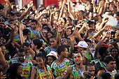 Salvador, Brazil. Bloco Timbalada carnival parade block; people in colourful costumes.