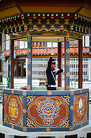 There are no traffic lights in Bhutan. This is the famous choreographed traffic policeman in the ornately decorated traffic island box in the capital city of Thimpu