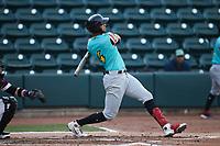 Pedro Gonzalez (4) of the Llamas de Hickory follows through on his swing against the Winston-Salem Rayados at Truist Stadium on July 6, 2021 in Winston-Salem, North Carolina. (Brian Westerholt/Four Seam Images)