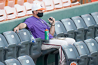 Head coach Monte Lee of the Clemson Tigers watches a fall Orange-Purple intrasquad scrimmage on Friday, November 13, 2020, at Doug Kingsmore Stadium in Clemson, South Carolina. (Tom Priddy/Four Seam Images)