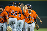 Osvaldo Duarte (2) of the Buies Creek Astros high fives his teammates following their win over the Winston-Salem Dash at BB&T Ballpark on April 15, 2017 in Winston-Salem, North Carolina.  The Astros defeated the Dash 13-6.  (Brian Westerholt/Four Seam Images)