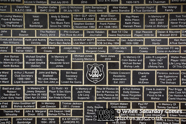 Bishop Auckland 3 West Auckland Town 1, 22/01/2016. Heritage Park, Northern League Division One. A memorial wall with dedications underneath the grandstand, pictured before Bishop Auckland host West Auckland Town in a Northern League division one match at Heritage Park. Bishop Auckland were winners of the Amateur Cup 10 times between 1895 and 1957 whilst their opponents won the Sir Thomas Lipton Trophy, regarded as the first world club tournament, in 1909 and 1911.  Bishop Auckland won this fixture 3-1, watched by a crowd of 422 at the ground they moved into in 2010. Photo by Colin McPherson.