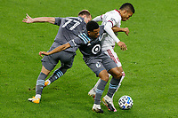 ST PAUL, MN - SEPTEMBER 27: Maikel Chang #16 of Real Salt Lake and Chase Gasper #77 of Minnesota United FC battle for the ball during a game between Real Salt Lake and Minnesota United FC at Allianz Field on September 27, 2020 in St Paul, Minnesota.
