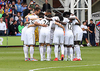 Pictured: Swansea players huddle prior to kick off<br /> Re: Premier League match between Crystal Palace and Swansea City at Selhurst Park on Sunday 24 May 2015 in London, England, UK