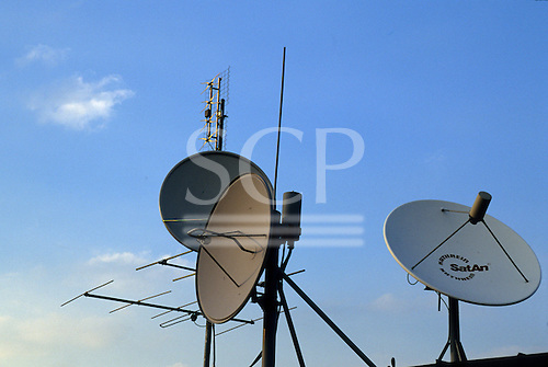 Budapest, Hungary. Television satellite dishes on a roof.