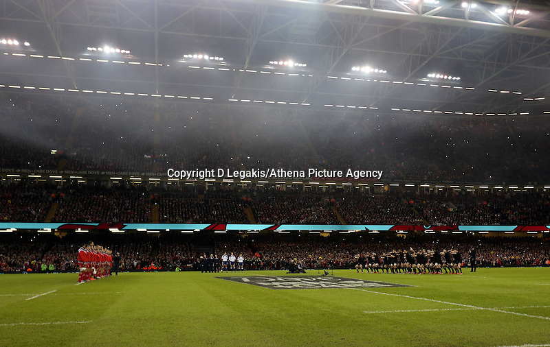 Pictured: New Zealand players (R) doing the haka, watched on by Wales players (L) Saturday 22 November 2014<br /> Re: Dove Men Series 2014 rugby, Wales v New Zealand at the Millennium Stadium, Cardiff, south Wales, UK.
