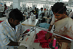 An indian man using Yamato machine  at Srinidhi's garment stitching factory in Tirupur, Tamilnadu. After lifting of quota system in textile export on 1st january 2005. Tirupur has become the biggest foreign currency earning town of India.