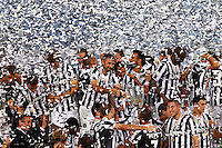 Calcio, Supercoppa di Lega: Juventus vs Lazio. Roma, stadio Olimpico, 18 agosto 2013<br /> Juventus players hold the Italian League Supercup trophy at the end of the football final match between Juventus and Lazio, at Rome's Olympic stadium,  18 August 2013. Juventus won 4-0.<br /> UPDATE IMAGES PRESS/Riccardo De Luca