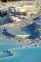 Pictures & Image  of Pamukkale Travetine Terrace, Turkey. Images of the white Calcium carbonate rock formations. Buy as stock photos or as photo art prints. 2 Pamukkale travetine terrace water cascades, composed of white Calcium carbonate rock formations, Pamukkale, Anatolia, Turkey