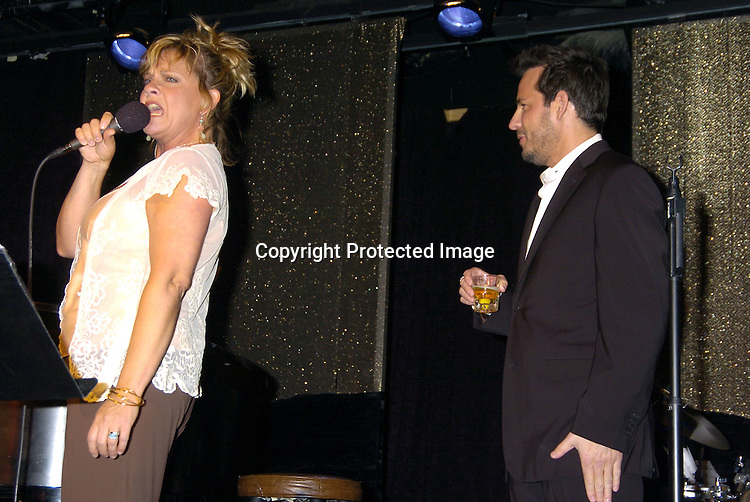 Kim Zimmer, Ricky Paull Goldin singing..at The Goldin and Park Cabaret starring Ricky Paull Goldin from Guiding Light and Michael Park from As The World Turns. Kim Zimmer, Robert Newman and Mandy Bruno also sang. This was at The Triad NYC on April 16, 2005, and  was a benefit for Bill Runyon's family. ..Photo by Robin Platzer, Twin Images